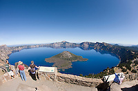 Tourists enjoying scenic view of Crater Lake National Park, OR.