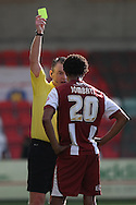 Sido Jombati of Cheltenham receives a yellow card. Skybet football league two match, Cheltenham Town v Torquay Utd at the Abbey Business stadium, Whaddon Rd in Cheltenham on Saturday 15th March 2014.<br /> pic by Mark Hawkins, Andrew Orchard sports photography.