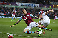 Stephen Kingsley of Swansea city ® tackles Alan Hutton of Aston Villa. Barclays Premier league match, Swansea city v Aston Villa at the Liberty Stadium in Swansea, South Wales on Saturday 19th March 2016.<br /> pic by  Andrew Orchard, Andrew Orchard sports photography.