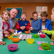 Board Chair Bob Schope and CEO Denise Day of YMCA of Greater Brandywine take part in egg dying with children in the West Chester Area YMCA's Montessori program.