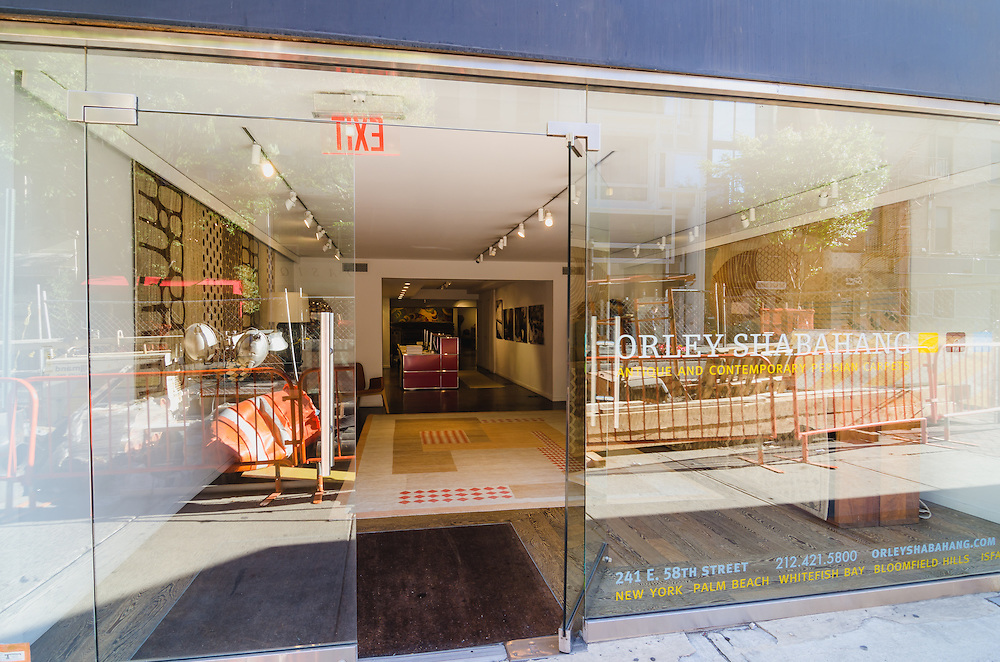 Photographs of Orley Shabahang store in New York, original persian silk carpets.