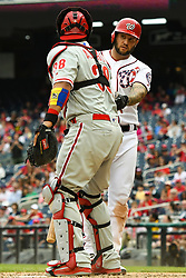 May 6, 2018 - Washington, DC, U.S. - WASHINGTON, DC - MAY 06:  Washington Nationals first baseman Matt Adams (15) looks at Philadelphia Phillies catcher Jorge Alfaro (38) after a fouled third strike and tag out during the game between the Philadelphia Phillies  and the Washington Nationals on May 6, 2018, at Nationals Park, in Washington D.C.  The Washington Nationals defeated the Philadelphia Phillies, 5-4.  (Photo by Mark Goldman/Icon Sportswire) (Credit Image: © Mark Goldman/Icon SMI via ZUMA Press)