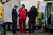 Kent Police officers arrest a Palestine Action activist who used a vehicle to block an entrance to the Instro Precision factory in Discovery Park on 4th October 2021 in Sandwich, United Kingdom. Instro Precision is a subsidiary of Israels largest publicly-traded arms company Elbit Systems supplying high precision military equipment and Palestine Action contends that Instro Precision equipment has been used by the Israeli military against the population of Gaza.