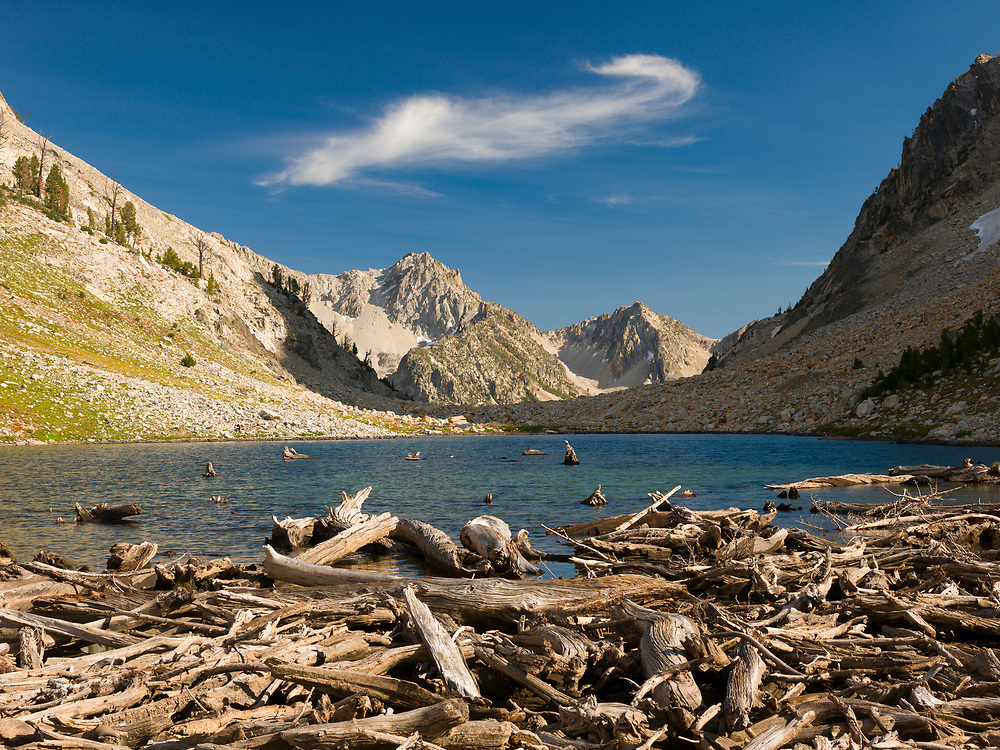 Avalanche Debris piles up at the outlet end of small lake just above Sawtooth Lake at the base of Mt. Regan in the Sawtooth Mountains.  Licensing and Open Edition Prints.