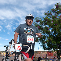 061415      Cayla Nimmo<br /> <br /> Daryl Petersen transitions from swimming to the bike ride of the Gallup Triathalon Saturday.