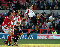 Picture: Henry Browne.<br /> Date: 25/01/2004.<br /> Nottingham Forest v Sheffield United FA Cup Fourth Round.<br /> <br /> Jack Lester of United tries to lob the Forest keeper, but narrowly misses.