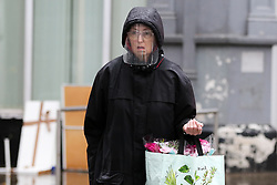 © Licensed to London News Pictures. 14/09/2021. London, UK. A woman wearing a shield in north London. Later today, Prime Minister, Boris Johnson will outline a 'winter plan' for dealing with an increase in coronavirus infections in the coming months and to avoid another national lockdown. It is expected that compulsory face coverings could be reintroduced in some settings. Photo credit: Dinendra Haria/LNP