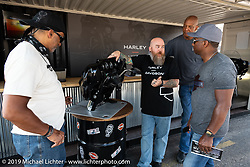 Harley-Davidson employee Jason Widget of Milwaukee showed visitors operation tips on the new Harley-Davidson entertainment system in the new concierge area in the Harley-Davidson footprint at the Sturgis Civic Center on Lazelle during Sturgis Black Hills Motorcycle Rally. SD, USA. Thursday, August 8, 2019. Photography ©2019 Michael Lichter.