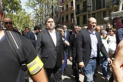 August 18, 2017 - unknown - Barcelona, Spain, August 18, 2017 : Oriol Junqueras, Vice President of the Catalan Parlament with the crowd walking down the Rambla after the minute of silence held on Plaza Catalonia for a terrorist white van running over tourist pedestrians walking down the Rambla on August 17, 2017 around 05:00pm. Photo credit : Marc Javierre-Kohan / Aurimages (Credit Image: © Marc Javierre Kohan/Aurimages via ZUMA Press)