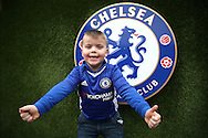 a Young Chelsea fan from North Wales looks on outside Stamford Bridge before k/o. Premier league match, Chelsea v Stoke city at Stamford Bridge in London on Saturday 31st December 2016.<br /> pic by John Patrick Fletcher, Andrew Orchard sports photography.