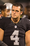 Oakland Raiders quarterback Derek Carr (4) during a preseason NFL game against the Tennessee Titans at Oakland Coliseum in Oakland, Calif., on August 26, 2016. (Stan Olszewski/Special to S.F. Examiner)
