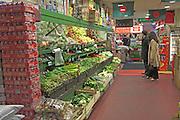 Vegetables on display in Asian supermarket, Brick Lane, London, England