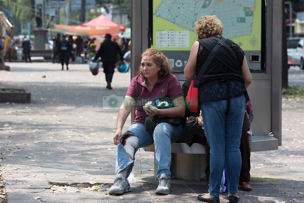 A survivorat the site of acollapsed building in the neighborhood of Condesa, after a quake rattled Mexico City, Mexico on September 19, 2017. The 7.1 magnitude earthquake rocked Central Mexico, killing dozens people and causing serious damage to buildings in the capital. The worst earthquake in the history of Mexico occurred on September 19, 1985, killing nearly 10,000 people. (Photo by Bénédicte Desrus/Sipa USA)