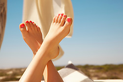Woman's Feet in the Air with Bright Pink Toenails