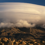El Capitan is obscured by a rare lenticular cloud in Guadalupe Mountains National Park, TX.