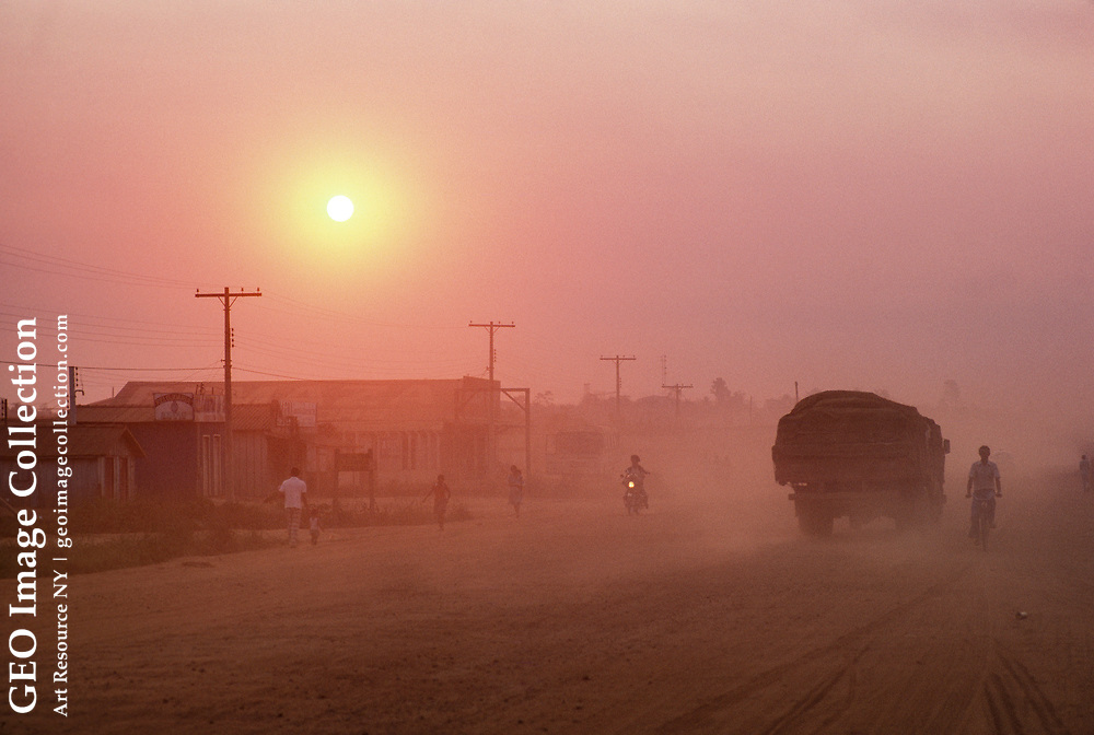 Dusty streets of a boom town that once was tropical moist forest.
