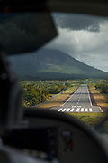 View of the Ometepe Island airport seen through the window of a landing airplane, Nicaragua