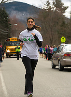A member of the Keene Middle School team wears a tag for 6 year old victim Emily Parker over her heart as she sets out on the course from Gilford Elementary School to Elm Street School during the 26.4.26 relay held Sunday morning.  (Karen Bobotas/for the Laconia Daily Sun)