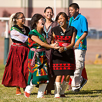 101112       Brian Leddy<br /> Harley Craig and Kia Sleuth dance with their classmates during a powwow song at Wingate High School. The school celebrated New Mexico's 100th birthday and Native American week with the launching of a rockets, singing and dancing.