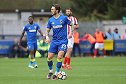 AFC Wimbledon defender Callum Kennedy (23) dribbling during the The FA Cup match between AFC Wimbledon and Lincoln City at the Cherry Red Records Stadium, Kingston, England on 4 November 2017. Photo by Matthew Redman.