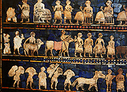 From the Standard of Ur (Peace side). Sumerian artefact (circa 2600 BC) excavated from the royal tomb in the city of Ur in the 1920's. South of what is now Baghdad in Iraq. It is an historical account of ancient warfare, and shows a king, subjects, musicians, soldiers and animals.