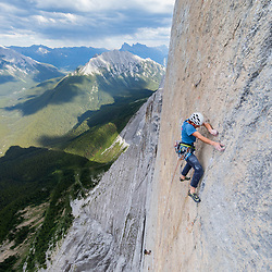 Dexter Bateman climbing The Shining, 5.13+  on Mt Louis in Banff National Park.