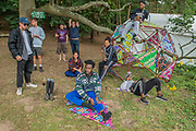 Boy Blue Entertainment relax before appearing via Sadlers Wells on the Waterfron stage  - The 2017 Latitude Festival, Henham Park. Suffolk.15 July 2017