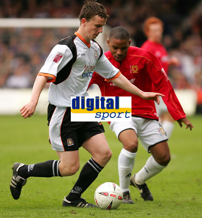 Photo:  Frances Leader.<br /> Luton Town FC v Milton Keynes Dons. The Coca-Cola League One. Kenilworth Road.<br /> 16/04/05<br /> Luton's Kevin Foley runs with the ball with The Dons Wade Small.