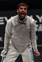 WUXI, July 27, 2018  Daniele Garozzo of Italy reacts after winning the men's foil team final between Italy and the United States at the Fencing World Championships in Wuxi, east China's Jiangsu Province, July 27, 2018. Italy beat US 45-34 and claimed the title of the event. (Credit Image: © Han Yuqing/Xinhua via ZUMA Wire)