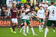 Beni Baningime (#6) of Heart of Midlothian FC tackles Joe Newell (#11) of Hibernian FC during the Cinch SPFL Premiership match between Heart of Midlothian and Hibernian at Tynecastle Park, Edinburgh, Scotland on 12 September 2021.
