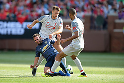 July 28, 2018 - Ann Arbor, Michigan, United States - Juan Mata(8) of Manchester United falls to the field while Nathaniel Philips (47) and Fabinho (3) of Liverpool fight for possession of the ball during an International Champions Cup match between Manchester United and Liverpool at Michigan Stadium in Ann Arbor, Michigan USA, on Wednesday, July 28,  2018. (Credit Image: © Amy Lemus/NurPhoto via ZUMA Press)