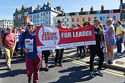 Labour Party supporters carry a banner in support of Jeremy Corbyn in Margate, Kent. July 2014 UK