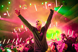 """© Licensed to London News Pictures . 05/02/2016 . Manchester , UK . BEZ ( Mark Berry ) . """" Hacienda Classical """" debut at the Bridgewater Hall . The 70 piece Manchester Camerata and performers including New Order's Peter Hook , Shaun Ryder , Rowetta Idah , Bez and Hacienda DJs Graeme Park and Mike Pickering mixing live compositions . Photo credit : Joel Goodman/LNP"""