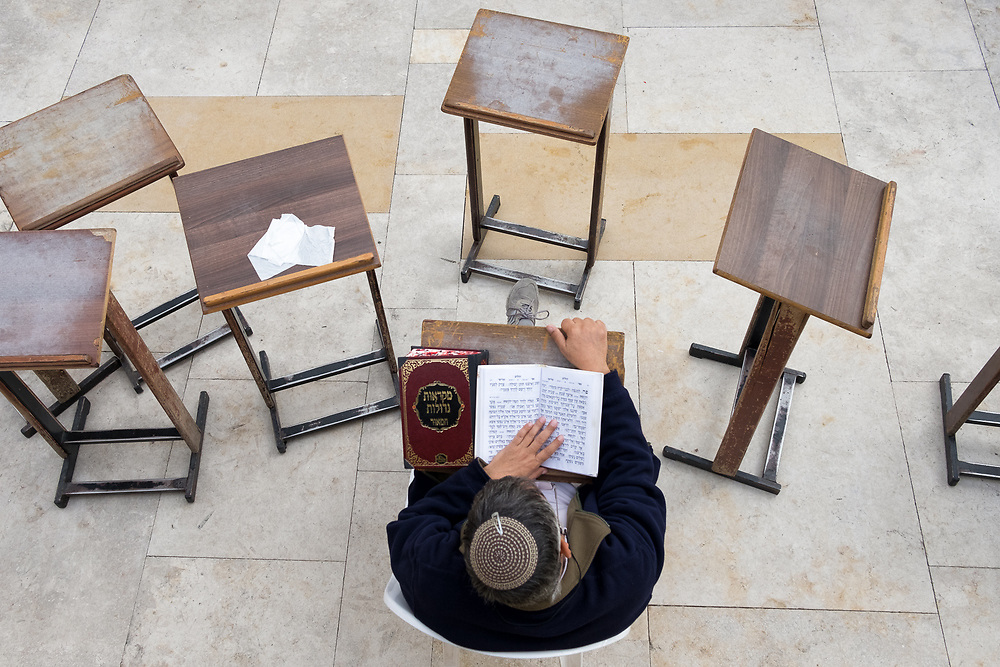 View from above of a jew man studying the Torah