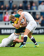 Australia flanker Angus Scott-Young is held by England fly-half Harry Mallinder during the World Rugby U20 Championship  match England U20 -V- Australia U20 at The AJ Bell Stadium, Salford, Greater Manchester, England on June  15  2016, (Steve Flynn/Image of Sport)
