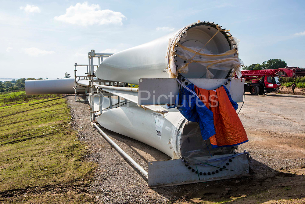 Wind turbine installation. The blades of a wind turbine before it is built, ready to attach to the main mast. Forest of Dean. Gloucestershire.