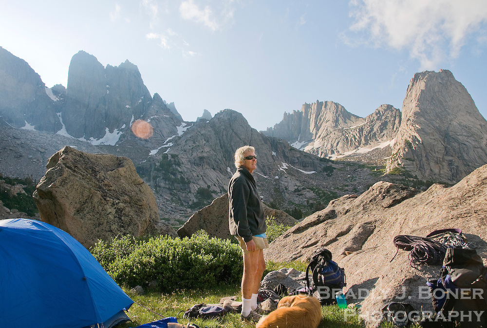 """Joe Kelsey pauses to take in the view of the Cirque of the Towers while unpacking gear after a recent hike into the Wind River Mountains. """"It's like being home,"""" Kelsey said of the popular climbing mecca."""