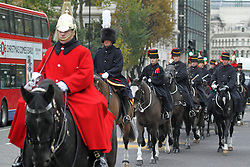 © Licensed to London News Pictures. 30/11/2013. Sacred soil from the battlefields of Flanders has been carried through the streets of London on a gun carriage. The soil arrived yesterday on a Belgian frigate and was loaded on to a gun carriage this morning. The gun carriage was drawn by six colour matched black Irish Draught horses and was taken to Wellington Barracks. Credit : Rob Powell/LNP