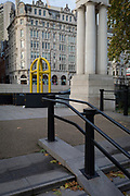 A landscape of Green Park and Piccadilly with a solid anti-terrorist barrier, on 19th November 2017, in London, England.