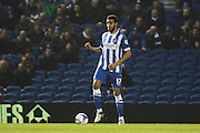 Brighton central defender, Connor Goldson (17) takes the ball forward during the Sky Bet Championship match between Brighton and Hove Albion and Reading at the American Express Community Stadium, Brighton and Hove, England on 15 March 2016. Photo by Geoff Penn.