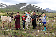 Stunning images reindeer herders of Mongolia<br /> <br /> Tsaatan people are reindeer herders and live in northern Khövsgöl Aimag of Mongolia. Originally from across the border in what is now Tuva Republic of Russia,the Tsaatan are one of the last groups of nomadic reindeer herders in the world. They survived for thousands of years inhabiting the remotest Ulaan taïga, moving between 5 and 10 times a year. <br /> The reindeer and the Tsaatan people are dependent on one another. Some Tsaatan say that if the reindeer disappear, so too will their culture. The Tsaatan depend on the reindeer for almost, if not all, of their basic needs:  their reindeers provide them with milk, cheese, meat, and transportation. They sew their clothes with reindeer hair, reindeer dung fuels their stoves and antlers are used to make tools. They do not use their animals for meat. This makes their group unique among reindeer-herding communities. As the reindeer populations shrink, only about 40 families continue the tradition today. Their existence is threatened by the dwindling number of their domesticated reindeer. Many have swapped their nomadic life for urban areas. <br /> <br /> Today, the Tsaatan's existence and traditional way of life is threatened by the dwindling number of their domesticated reindeer, for which there are multiple and complex causes suggested, such as a surge in commercial hunting for deer, wild boar, moose, and other animals. This has meant that wolves now have to search for alternative prey, and often target the reindeer herds. The loss of other wildlife has also meant that Tsaatan hunting parties now have to search further afield, and one day hunting trips are turning into four or five day excursions, sometimes leaving them with little choice but to slaughter more of their precious herds for food. With increasing pressures, and more families and young people choosing to swap their nomadic life for urban areas, who knows how long the remaining Tsaatan nomads and their reindeer will be able t