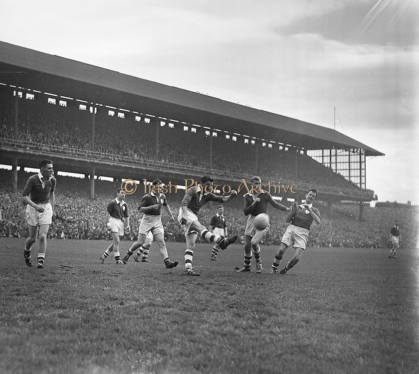 All Ireland Senior Football Championship Final, Louth v Cork .22.09.1957, 09.22.1957, 22st September 1957, ..Louth 1-09 Cork 1-07, ..22091957AISFCF, ACTION DURING THE ALL IRELAND SENIOR GAELIC FOOTBALL FINAL BETWEEN LOUTH AND CORK IN CROKE PARK ON SEPTEMBER 21ST 1957, LOUTH WON THE SAM MAGUIRE CUP 1-9 TO 1-7,..RESCAN/ Check.is this originally a square negative?.