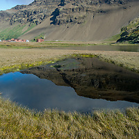 Mountains reflect in a pond near the abandoned British whaling station at Stromness Bay, South Georgia, Antarctica.