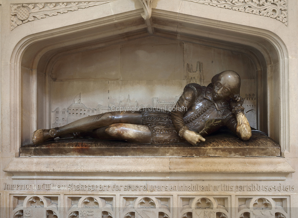 Shakespeare Memorial, with an alabaster figure, 1912, of William Shakespeare, 1564-1616, who lived in Southwark, 1912, by Henry McCarthy, 1839-1917, in the South aisle of the choir of Southwark Cathedral, or the Cathedral and Collegiate Church of St Saviour and St Mary Overie, at London Bridge, Southwark, London, England, UK. Above the stone niche is the Shakespeare Memorial Window, 1954, by Christopher Webb, 1866–1966, commemorating the playwright and replacing the original window destroyed in the Second World War. The original priory church was begun here in 1106 and parts of the Gothic building built 1220-1420 remain, although the church was altered until the 19th century. Picture by Manuel Cohen