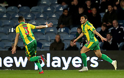 West Bromwich Albion's Jefferson Montero (right) celebrates scoring his side's first goal of the game with team mate Kieran Gibbs during the Sky Bet Championship match at Loftus Road, London.