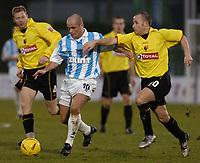 Fotball<br /> England 2004/2005<br /> Foto: SBI/Digitalsport<br /> NORWAY ONLY<br /> <br /> Coca Cola Championship<br /> 03/01/2005<br /> <br /> Brighton v Watford<br /> <br /> Brightons Charlie Oatway tries to escape the Watford defence.