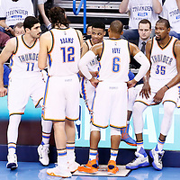 08 May 2016: Oklahoma City Thunder guard Russell Westbrook (0) talks to Oklahoma City Thunder center Steven Adams (12), Oklahoma City Thunder center Enes Kanter (11), Oklahoma City Thunder guard Randy Foye (6) and Oklahoma City Thunder forward Kevin Durant (35) during the Oklahoma City Thunder 111-97 victory over the San Antonio Spurs, during Game Four of the Western Conference Semifinals of the NBA Playoffs at the Chesapeake Energy Arena, Oklahoma City, Oklahoma, USA.