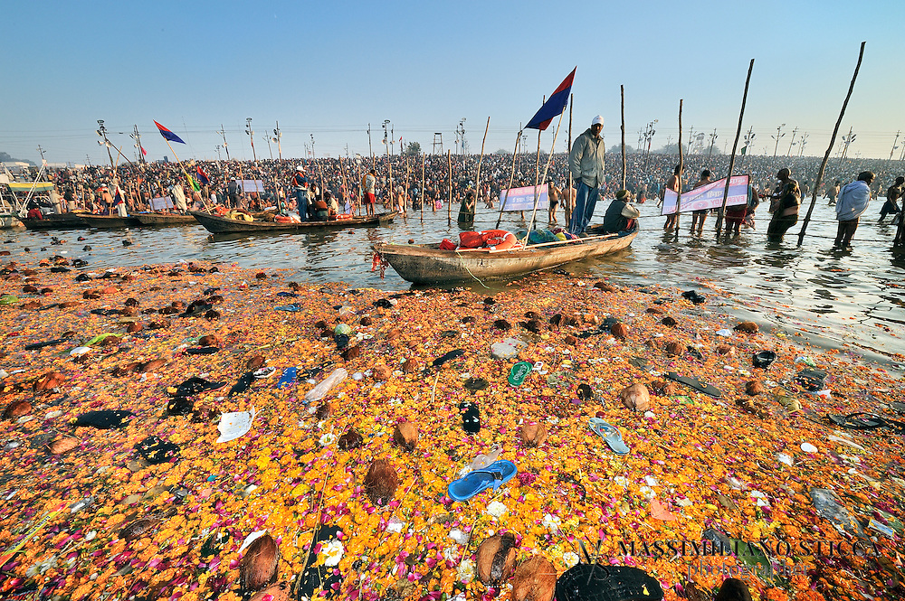 After many days of offering rivers are full of flowers, coconuts and polluting garbage like bottles and plastic bags. The shoes found here come from the capsizing of a floating brige on River Ganges and from pilgrims in water.