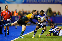 Bath Winger Semesa Rokoduguni is tackled by Northampton Winger George North - mandatory by-line: Rogan Thomson/JMP - Tel: 07966 386802 - 23/05/2014 - SPORT - RUGBY UNION - Cardiff Arms Park, Wales - Bath Rugby v Northampton Saints - Amlin Challenge Cup Final.