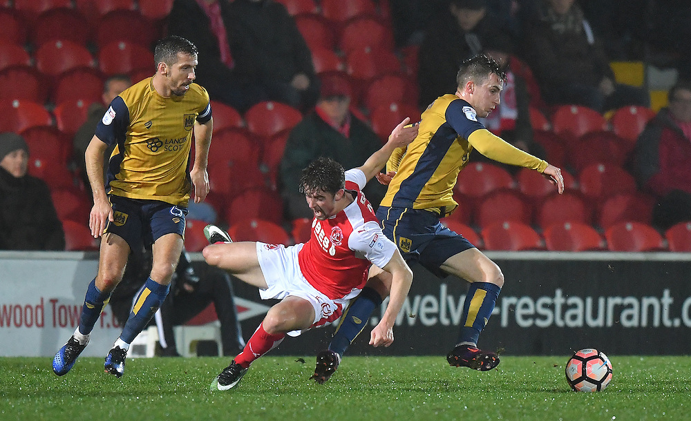 Fleetwood Town's Jack Sowerby is tackled <br /> <br /> Photographer Dave Howarth/CameraSport<br /> <br /> Emirates FA Cup Third Round Replay - Fleetwood Town v Bristol City - Tuesday 17th January 2017 - Highbury Stadium - Fleetwood<br />  <br /> World Copyright © 2017 CameraSport. All rights reserved. 43 Linden Ave. Countesthorpe. Leicester. England. LE8 5PG - Tel: +44 (0) 116 277 4147 - admin@camerasport.com - www.camerasport.com